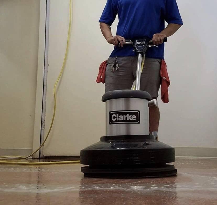 A marble floor being buffed by a Bluwolf employee